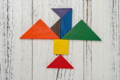 Tangram shaped like a flying bird. Wooden tangram shaped like a flying bird Stock Photo