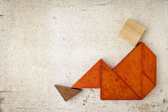 Tangram sitting figure royalty free stock image