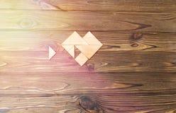 Tangrampuzzlespielwartung erfüllen lizenzfreie stockfotografie