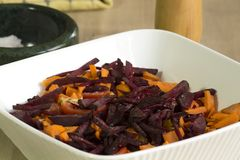 Tangy beetroot and bell pepper salad. Sliced tomato, beetroot and cubed bell pepper are mixed together with almonds, sesame seeds, lemon juice and rock salt Royalty Free Stock Images