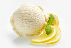 Tangy fresh lemon citrus sorbet or ice cream. With sliced fresh fruit garnished with mint alongside over a white background royalty free stock photo