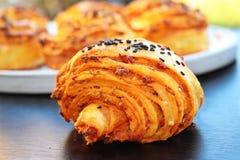 Tangzhong sausage swirl with black sesame stock photos