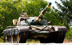A tank. A heavy armored, military, camouflage color  tank Royalty Free Stock Photo