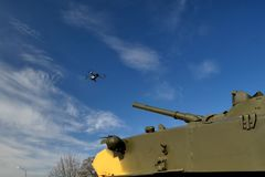 Tank aims a gun at the drone. Fighting drones and quadrocopters stock images