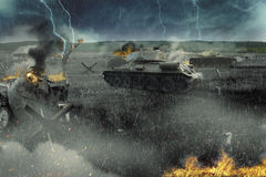 Tank battle in the burned-out field. The attack near the village Royalty Free Stock Image