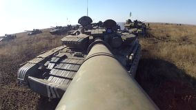 Tank with camera on the large-calibre cannon is rotating its gun turret. Tank on the battlefield stock video footage