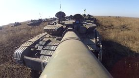 Tank with camera on the large-calibre cannon is rotating its gun turret stock video