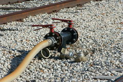 Tank car fill valve. Railroad tank car fill valve used for loading and unloading liquids into or out of a railroad tank car stock images