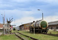 Tank car LNG by rail on oil storage tanks in fuel terminal.  Discharge of liquefied petroleum gas, gasoline stock images