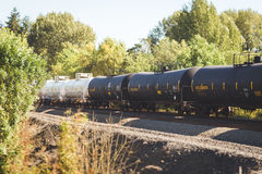 Tank cars on a railroad in trees Stock Photo