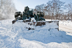 Tank cleans the road from snow. IMR-2 clears snow from the road after heavy snowfall Stock Photography