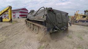 Tank driving at sands. At cloudy day stock video footage