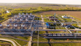Tank farm for bulk petroleum and gasoline storage next to rail line. Aerial view stock video footage