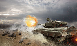 Tank. Heavy armor in the field of battle Stock Images