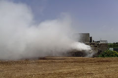 Tank Merkava is making smoke screen for defending. Israel tank Merkava making smoke screen cloud to cover up for defending in daylight during military manoeuvres Royalty Free Stock Photography