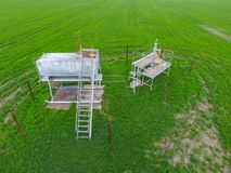 Equipment of an oil well. A tank with methanol near the oil well. Shutoff valves and service equipment. A tank with methanol near the oil well. Equipment of an royalty free stock image