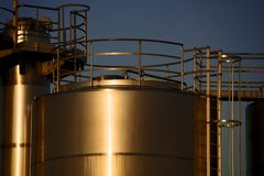 Tank and morning sun /2. Some containers in the morning light Royalty Free Stock Photos
