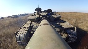 Tank is moving back with camera on the large-calibre cannon. The machine also rotating gun turret stock video footage