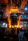 Tank pours the liquid steel in the molds.  royalty free stock photography