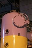 Tank at a power plant. Different size and shaped pipes at a power plant Stock Photography