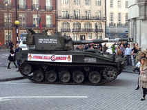 Tank Protest at BBC Broadcasting House. LONDON, UK - MARCH 20, 2015:  A tank driven by The Stig delivering a petition to the BBC in support of Jeremy Clarkson Royalty Free Stock Image