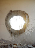 Tank shell impact hole in the wall Royalty Free Stock Photo