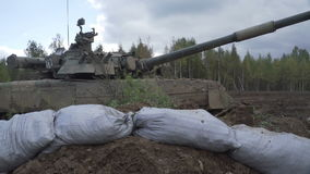 Tank for shelter. The trenches and military barricades of sandbags.  stock footage