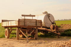 The tank spreader and trailer on a rural field. Stock Image