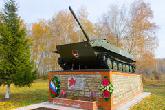 The tank standing on a monument. A monument to the died Soviet soldiers. Stock Photos
