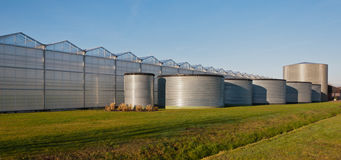 Tank storage for a modern greenhouse complex Stock Photos