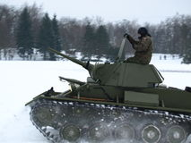 Tank T-70 while driving in the snow. Royalty Free Stock Images