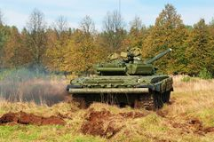 The tank t-72 in movement. The tank t-72 moves across the field grown with a wild grass Stock Photography