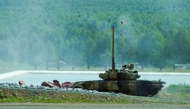 Tank T-80 after water obstacle. Shooting tank T-80 moving through cross-country terrain with obstacles Royalty Free Stock Images