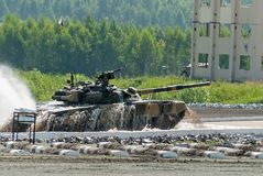 Tank T-80 moves from water ford Stock Photo