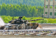 Tank T-80 moves from water ford Stock Photos