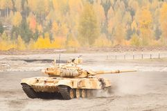 Tank T-90S moves with turret turned back Stock Photography