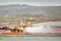 Tank T-90S moves after water ford Stock Photos