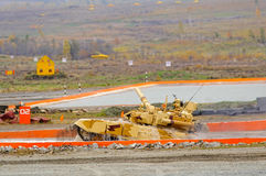 Tank T-90S moves after water ford. Nizhniy Tagil, Russia - September 25. 2013: Modernized tank T-90S moves after overcoming of water of 1.5 meters in depth Royalty Free Stock Image