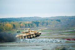 Tank T-90S. Russian military tank T-90S with Obstacle overcoming royalty free stock photography