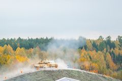 Tank T-90S shoots on hill Royalty Free Stock Photo