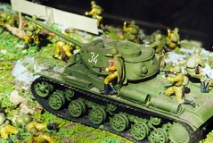 Tank of times of World war with infantrymen Stock Photos