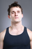 Tank Top Portrait. A young tough wearing a tank top Royalty Free Stock Photography