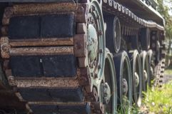 Tank tracks military vehicle close up stock photo