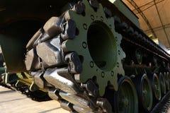 Tank tracks and steel wheels Stock Photos