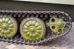 Tank tracks and steel wheels huge green panzer. Stock Images
