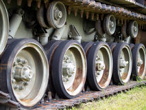 Tank tread and road wheels stock image