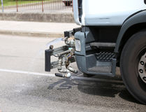 Tank truck city street cleaning with powerful water jet Royalty Free Stock Photo