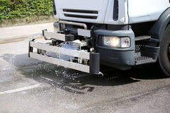 Tank truck city street cleaning with powerful water jet Stock Photography