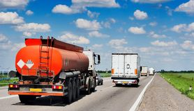 The tank truck is moving along the highway. Royalty Free Stock Photography