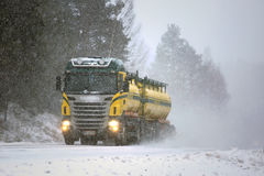 Tank Truck Trucking in Blizzard stock photography